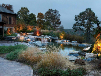 landscape lighting around pond with water features