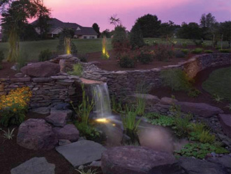 fish pond with submerged underwater lighting and landscape spotlights around the outside
