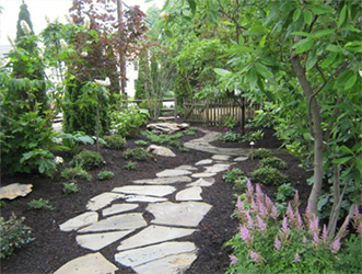 hidden garden space with random flagstone walkway