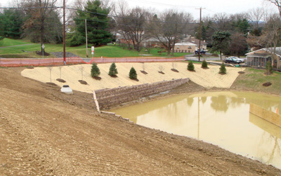 sediment pond with retaining wall decorative landscaping and hydroseeding